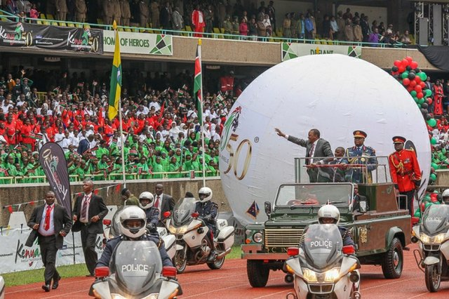 President Kenyatta is driven through the Kenya at 50 celebration grounds
