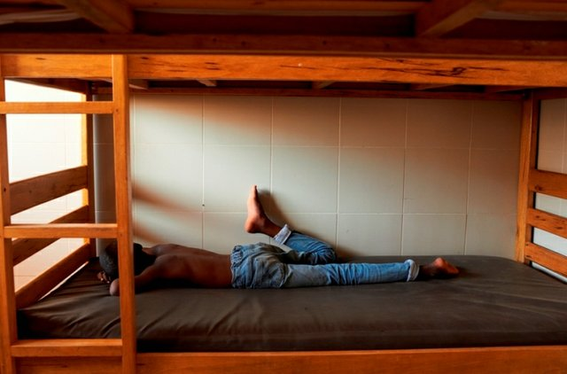 A boy sleeps during the afternoon siesta at the Samu Social shelter in Dakar.