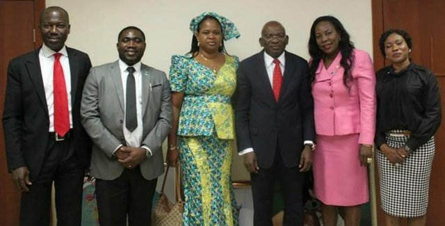 Rotary Club of Abuja-Gwarimpa members pose with Mr Roberts U. Orya, MD&CEO NEXIM Bank after presenting him an award in recognition of his contribution to the advancement of Nigeria's Banking sector