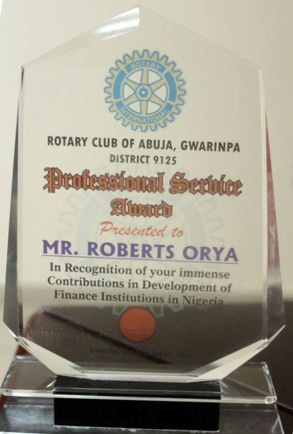 The Awards Plaque from Rotary Club of Abuja-Gwarimpa to Mr Roberts U. Orya, MD&CEO NEXIM Bank