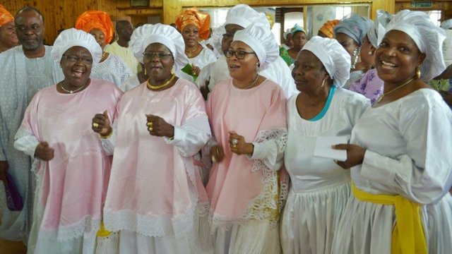 Princess Adenuga joined in thanksgiving by some female church members
