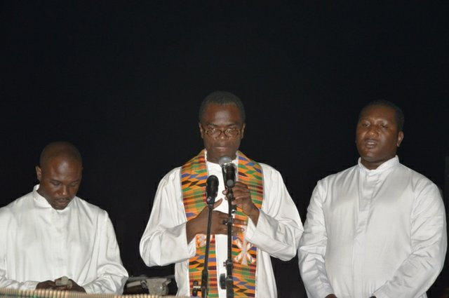 Priests offering prayers for Komla