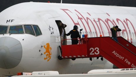 Passengers dis-embarking hijacked aircraft