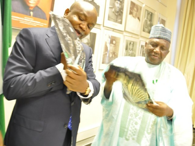Chairman of the Governing Board of the National Lottery Regulatory Commission - Damian. D. Dodo, SAN presents a gift to Dr Dalhatu Tafida