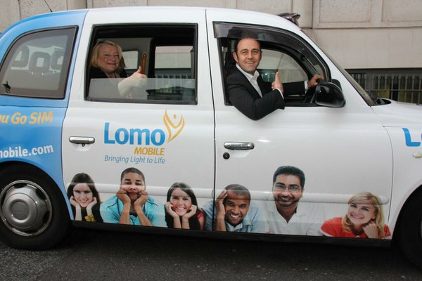 Lomo's Kim Delve and Paul Schonewald in one of the Lomo Cabs being used for the marketing campaign