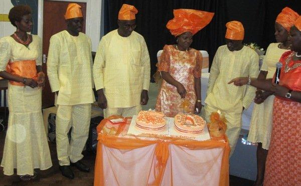 (L to R) Elizabeth, Adeiza,Michael,Martha (cutting the cake), Omeiza, Lois and Mariama