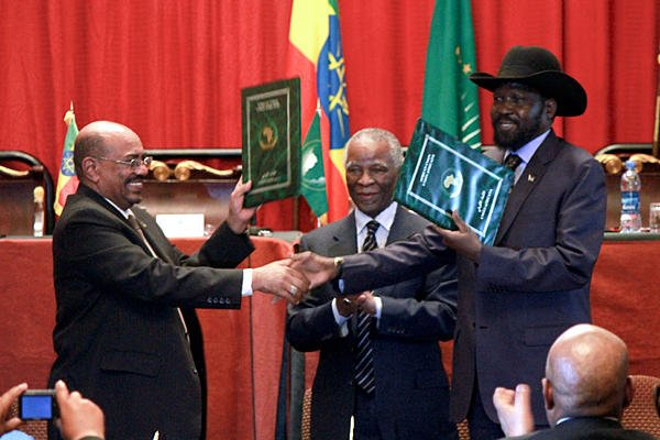 Sudan's President Omar al-Bashir and South Sudan's President Salva Kiir (right) after reaching a deal on economic and security agreements.