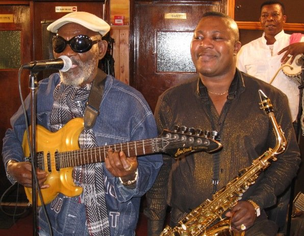 Fatai Rolling Dollar with musician Segun Vibes