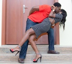 Babajide and Olajumoke in a loving pose