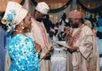 Nigeria's Former Chief Justice of the Federation - Alfa Modibbo Belgore handing over the marriage certificate to the couple