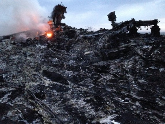 Debris from MH17 still on fire