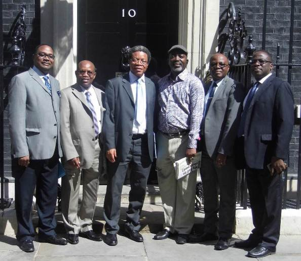 A delegation of APC UK pose in front of 10 Downing Street