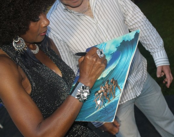 Maizie Williams signs album for Jay from LEXUS Car after concert