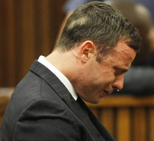 Oscar Pistorius cries as the 'Not Guilty' verdict for murder is read out