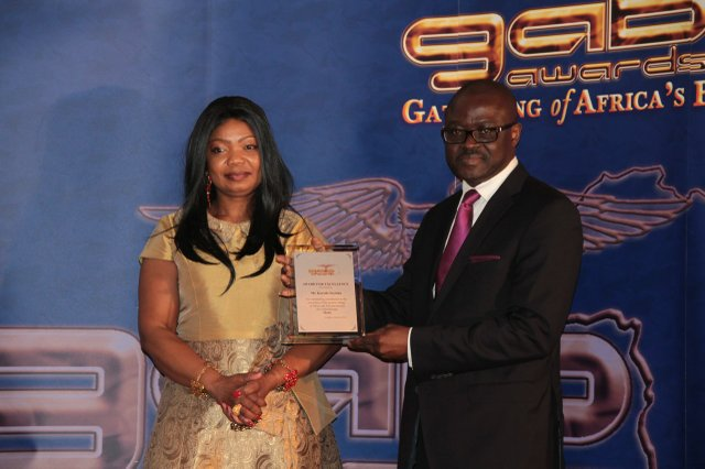 Cllr Susan Fajana-Thomas presents GAB Award to Mr Kayode Soyinka, Publisher of Africa Today magazine.jpg