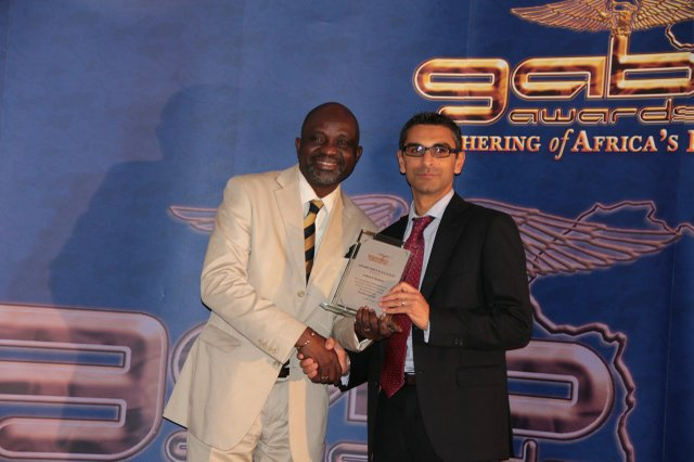 Black Business Awards Founder - Mr Sunny Lambe (left) poses with Mr Anu Gokani who represented GAB Awards recipient Ashish Thakkar.jpg