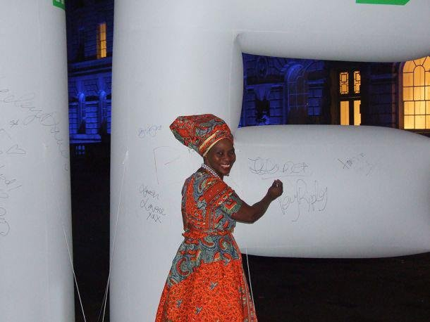 Positive Runway's Justina Mutale signing the IF inflatable