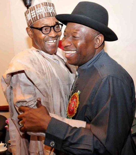 Muhammadu Buhari and Goodluck Jonathan embrace each other