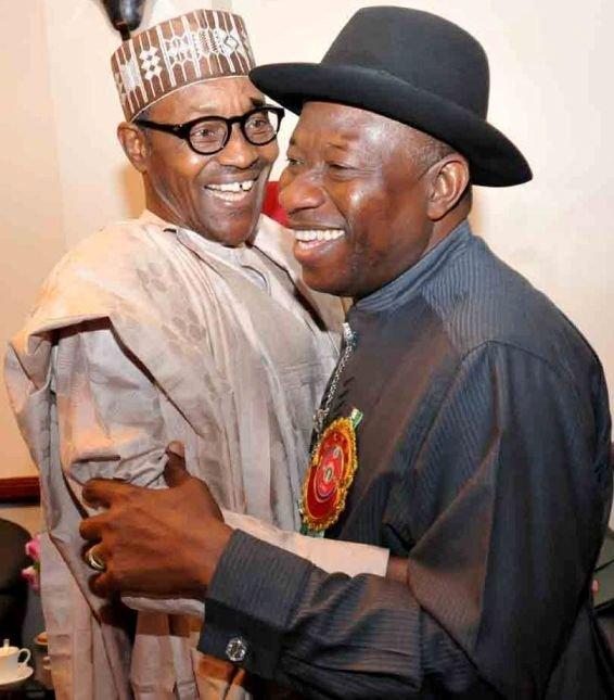 Muhammadu Buhari and Goodluck Jonathan embrace each other