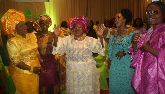 Thanking God with the Celebrant - guests including Pastor Oyebobola (left) and Pastor Victoria Oladipupo (4th from left).jpg