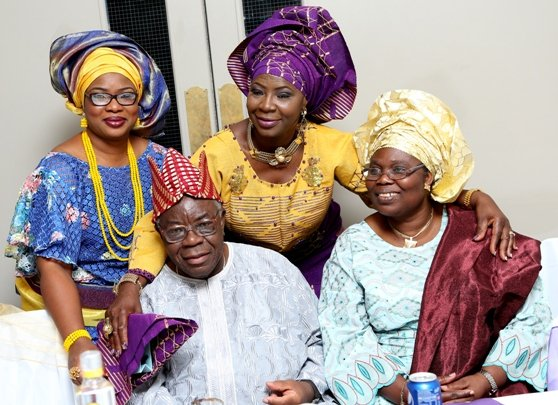 The celebrant poses with her dad - Pa Olunlade and his wife