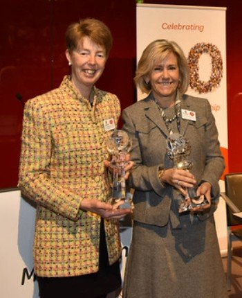 Post Office's Chief Executive Officer - Paula Vennells and MoneyGram's Executive Chairman - Pam Patsley exchange trophies to commemorate the milestones