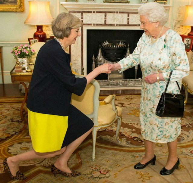 Theresa May with the Queen as she was invited to form a new government in Britain