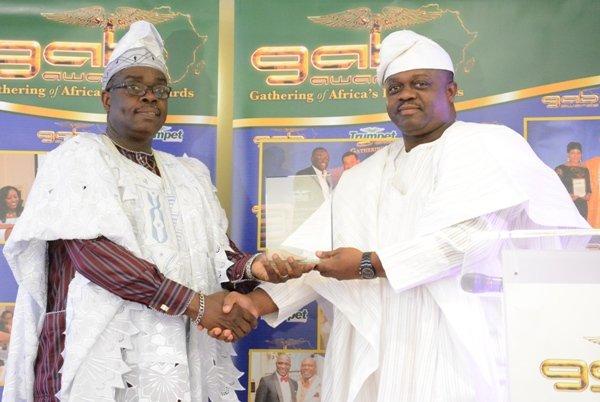 Senator Lanre Tejuoso receives his award from GAB Founder - Femi Okutubo at GAB 2015