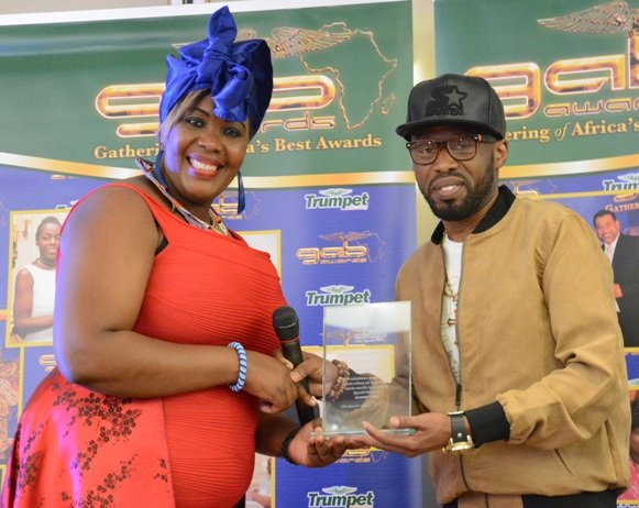 Janet Wainana of UK-ENTV and Organiser of Face of Kenya paegeant presents GAB Award to Shoggy Tosh at GAB Awards 2015
