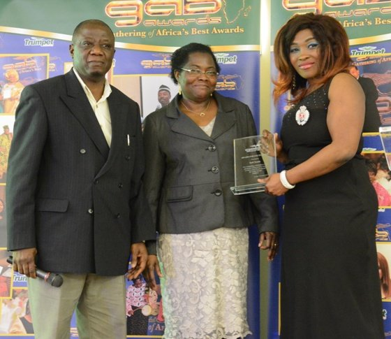 Ibiyemi Alabi - Founder of Kaft Trendz (far right) receives her award from Mr & Mrs Joseph Oladosu of Action for Community Development at GAB Awards 2016