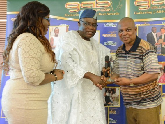 Miss Dami Okutubo and Mr Adewale Okutubo present GAB Award to Mr Isaac Adegbite of Adesons Productions at GAB Awards 2015