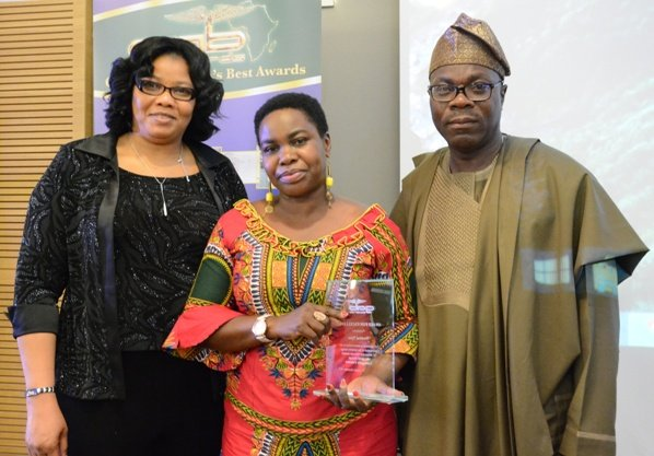 Wambui Njau (centre) was presented her GAB Award by Mr & Mrs Paul Olubunmi of PK Sales and Lettings at GAB Awards 2015