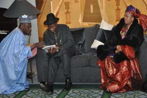 President Goodluck Jonathan going through a document with Nigerian High Commissioner, Amb Dalhatu Tafida on arrival of the President and First Lady Dame Patience.jpg