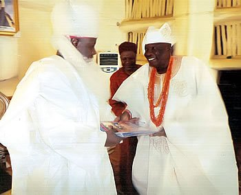 An exchange of gifts between the Emir of Bauchi - Alhaji Rilwanu Suleiman Adamu and the Alaafin of Oyo's Ambassador - Aare Ayandotun Ayanlakin