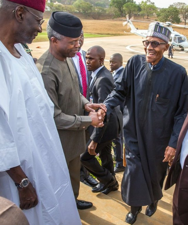 Acting President Yemi Osinbajo welcomes President Buhari at Aso Rock Helipad