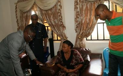 Kwara State Governor -  Dr Abdulfatah Ahmed, Uncle of late Commissioner of Police -  Mr. Ejike Asadu,  his Widow - Mrs Oby Asadu and Son - Mr Onyekachi Asadu, during the Governor's visit to the deceased's family house in Enugu