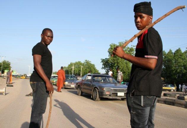 CJTF Vigilantes with sticks (Credits - Obi Anyadike - IRIN)