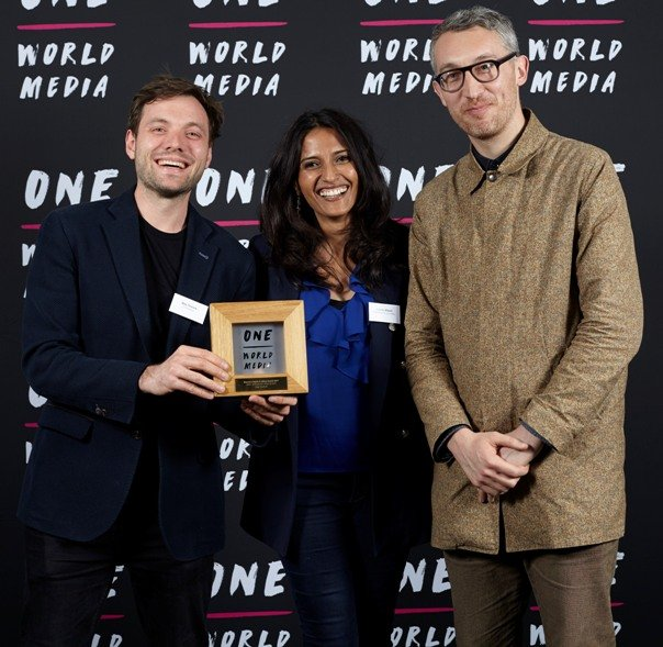 Max Thurlow and Alex Hoffman winners of the Women's Rights in Africa Award with TV presenter Tazeen Ahmed at the One World Media Awards
