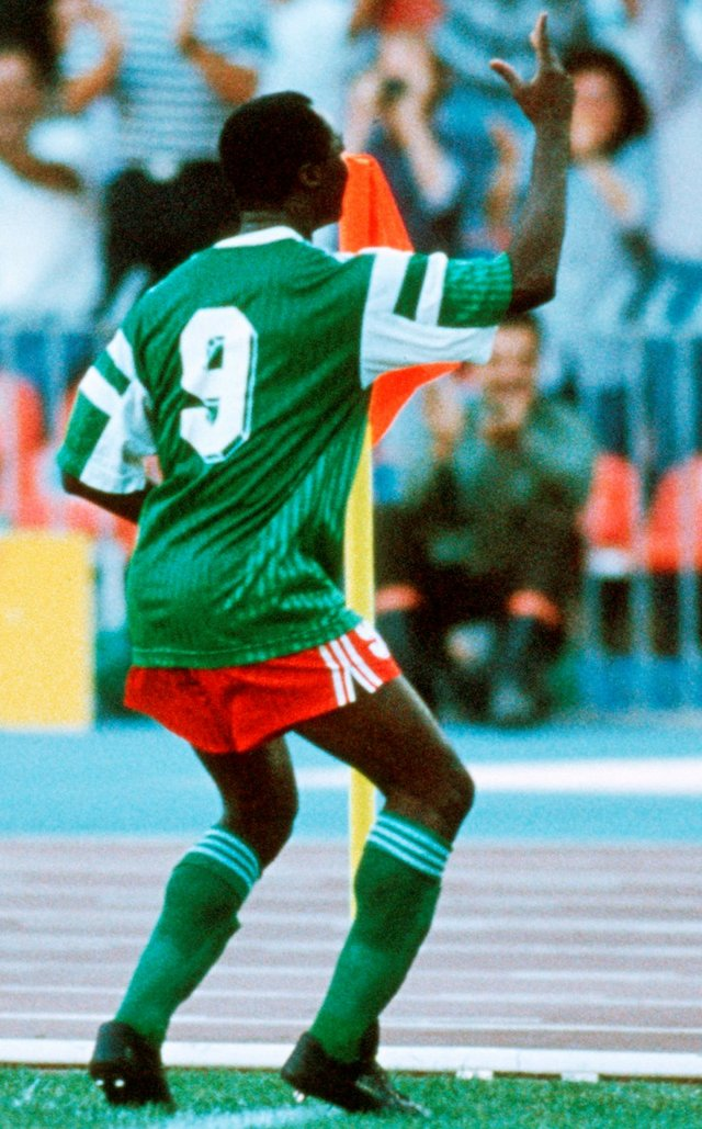 Roger Milla doing his famous flag post victory dance