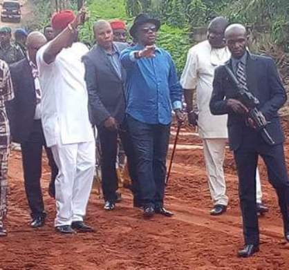 Aloysius Nnamdi Ikegwuonu and Governor Willie Obiano inspecting a road under construction