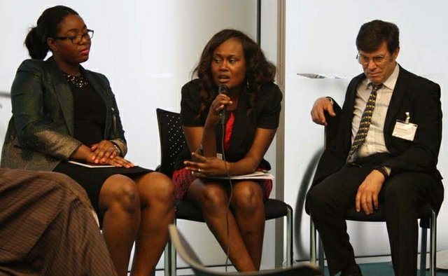Toyin Odusina (centre) speaking during an event organised by the Engineering Forum of Nigeria (UK)