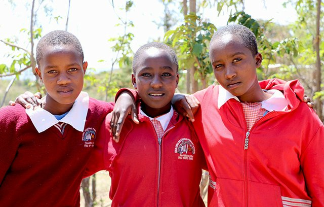 Faith (centre) with her friends Sylvia (right) and Vivian, who all ran away from home to avoid female genital mutilation and child marriage.