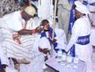 Ooni beckons to Rev Ajayi to move closer.jpg