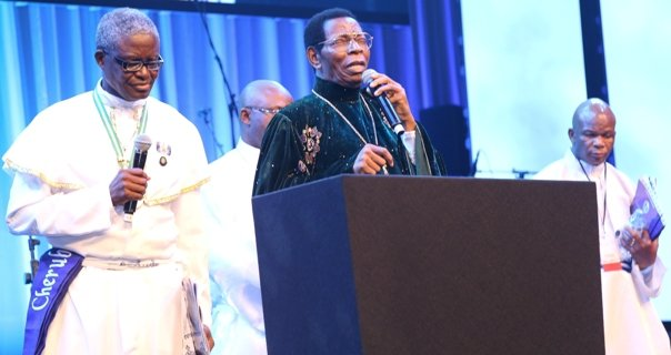 Pastor of the Celestial Church of Christ worldwide - Rev Emmanuel Mobiyina Oshoffa (middle) addressing the gathering.jpg