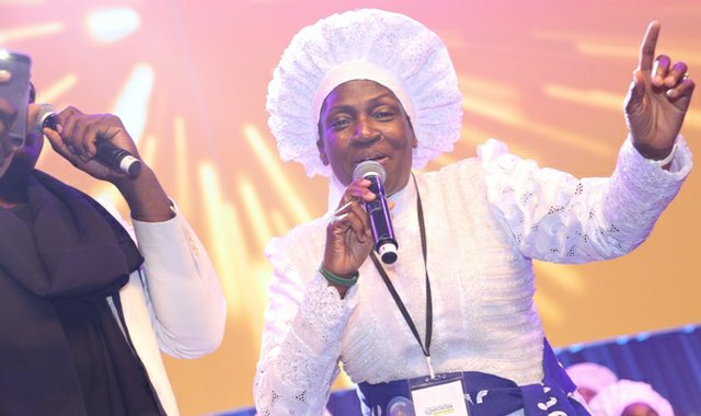 Rev Esther Ajayi performing with Muyiwa Riversongz.jpg