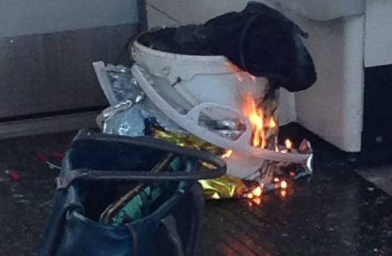 The bucket carrying the device on fire in the train carriage