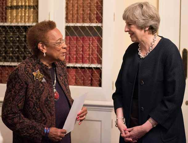 Prime Minister Theresa May chats with Dawn Hill, Chair of the Black Cultural Archives in Brixton