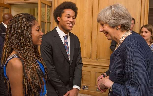 Prime Minister Theresa May meets brother and sister Isata and Sheku Kanneh-Mason, who performed at the reception