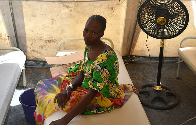 Yana Duka is one of 35 cholera patients in a provisional health facility in Muna camp. She lost her pregnancy after falling ill.