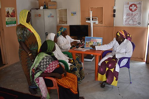 Nurses conduct an information session on cholera prevention for pregnant women in UNFPA's maternity centre in Muna camp outside Maiduguri.